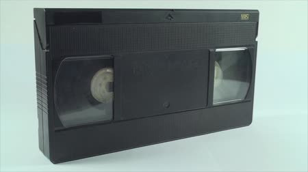 videocassette : Video Tape Isolated On White, Vintage, Media, Retro, Old, Pan Shot Stock Footage