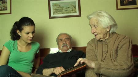 retirement : Grand Grand Mother, Grand Father, And Grand Daughter Laughing And Talking At Family Photos, Low Angle Shot