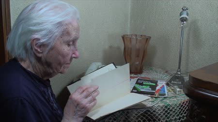 adresář : 98 Years Old Woman,Searching Through Address Book, Communication, Elderly, Phone