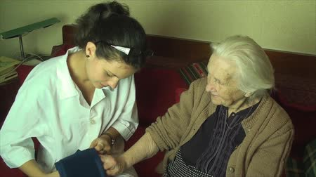 hemşirelik : Medical Student Practicing On Her Great Great Grandmother, Blood Pressure