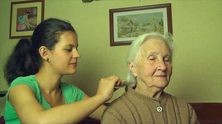 omuzlar : Grand Grand Daughter Combing Her 98 Years Old Grand Grand Mother Hair