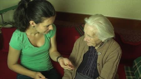 opieka : Grand Daughter Giving Pills To Her Grand Mother, Medical, Elderly, Health, Care