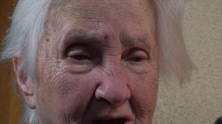 gondol : 98 Years Old Woman Holding A Photo Of Herself 60 Years Younger, Zoom Out