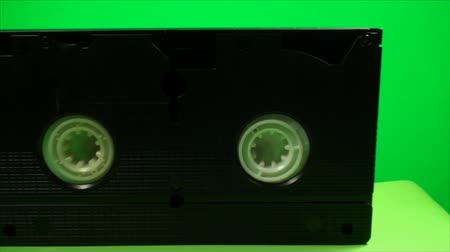 videocassette : Vintage VHS Video Tape, On A Green Screen, Chroma, Key, Pan