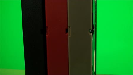 videocassette : Stack Of Vintage VHS Cassettes On A Green Screen, Chroma, Key, Video, Data, Pan