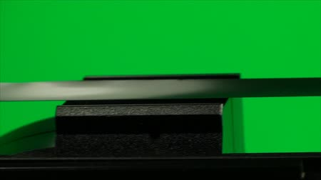 videocassette : Vintage VHS Video Tape, On A Green Screen, Tape, Close Up, Pan
