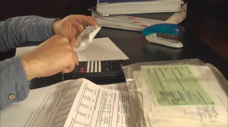 impostos : Young Accountant Hands Calculating Taxes Late At Night, Economy, Business Stock Footage