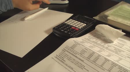 бухгалтер : Young Accountant Hands Calculating Taxes Late At Night, Economy, Close Up