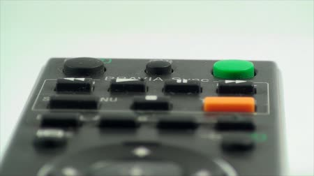 кнопка : Finger Touching The Stand By Button On A TV Remote, Extreme Close Up Front Shot