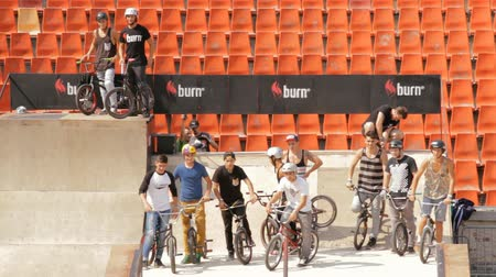 bmx : BMX Bikers Warming Up For Extreme Sports Contest, Ramp, Speed, High Angle Pan Stock Footage