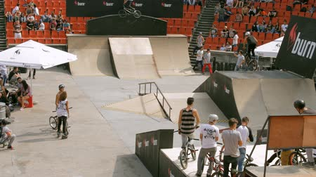 bmx : BMX Bikers Warming Up For Extreme Sports Contest, Ramp, Speed, High Angle