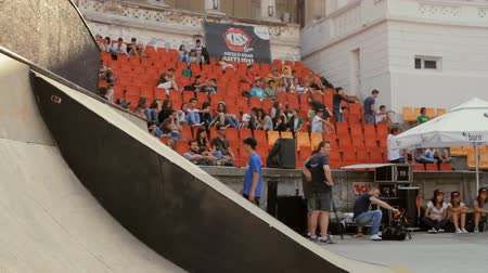 rampa : Skaters Warming Up For Extreme Sports Contest, Ramp, Speed, Low Angle Pan