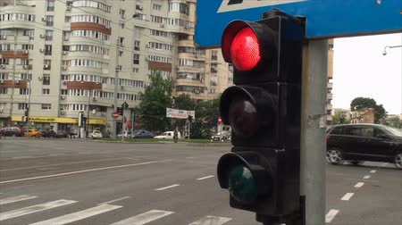 no traffic : Red Stop Light Turns Green In A Busy Intersection, Heavy Traffic, Sky, Downtown