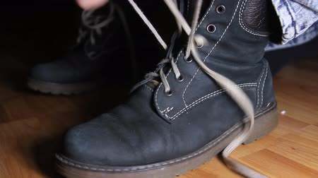 süet : Woman Hands Taking Of Shoelace From Her Boot, Shoelace, Hands, Boot, Detail Stok Video