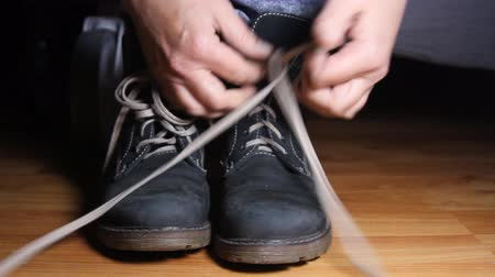footgear : Woman Hands Untying Shoelaces, Boots, Hands, Shoelace, Front Shot Stock Footage