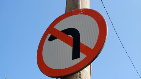 conventional : No Left Turn Sign, Traffic, Town, Summer Day, Urban Setting