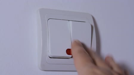 comutar : Hand Switching On The Light, Double Switch, Apartment, Detail Stock Footage