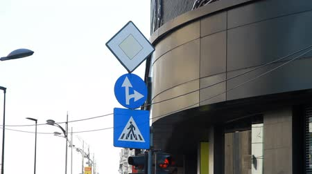 conventional : Pedestrian Sign, Ahead And To The Right, Priority Sign, Street Signs, Pan Stock Footage