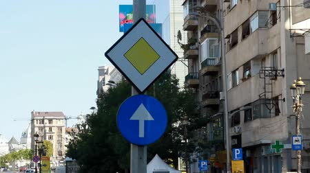 priority : Priority And Just Ahead Sign, Traffic, Street Sign, Urban Setting, Pan Stock Footage