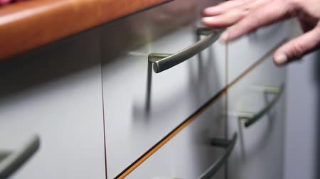 detail : Woman Hand Opening Drawers Of A White Kitchen Cupboard, Close Up Stock Footage