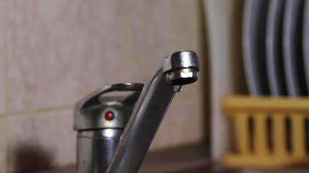 leaking : Water Dripping From A kitchen Sink Faucet, Waste, Negligence, Tilt Stock Footage