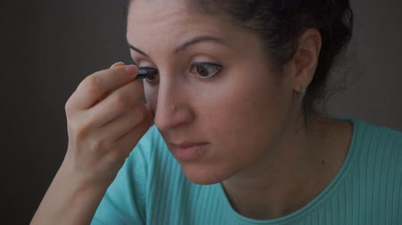 glamourous : Brunette girl doing eyeliner Stock Footage