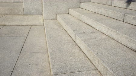 paving : Man goes down stairs Stock Footage