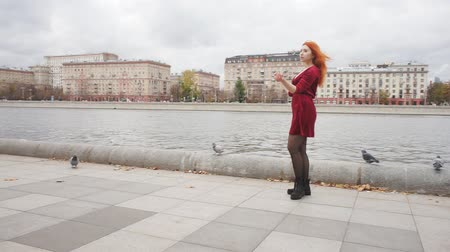 fulllength : Charming girl dancing near the river