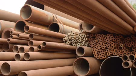 korozyon : Rusty metal, iron, long bunch pipes in several different diameters together.