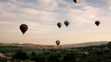 from air : Hot air ballon tour, voyage, trip, journey, adventure at Cappadocia, Urgup, Turkey. Colorful hot air balloons flight on sky. The area is a popular tourist destination, as it has many areas with unique geological, historic, and cultural features.  The regi