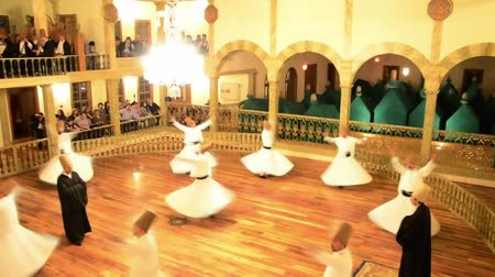 whirling : Whirling dervishes are dancing on a hall for an Islamic ritual  Stock Footage