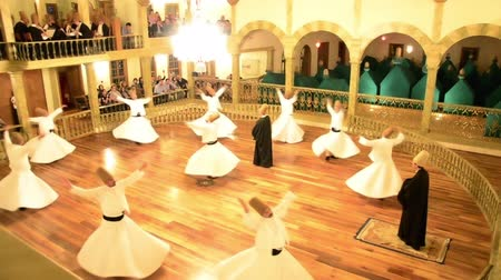 whirling : Whirling dervishes are dancing on a hall for an Islamic ritual