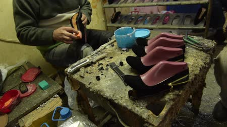 pincher : Shoe maker, master, craftsman, workman is manufacture, produce, make  oxford style man shoes in a small atelier.