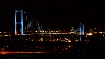освещать : Illuminated Bosphorus Bridge at night blue lights Стоковые видеозаписи
