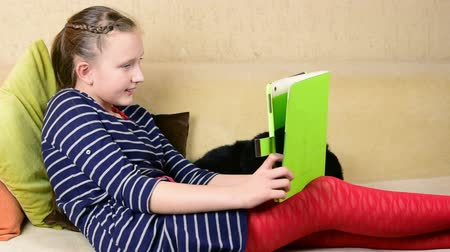 teenager : Blonde beautiful teenage girl play game by tablet computer at home close up Stock Footage