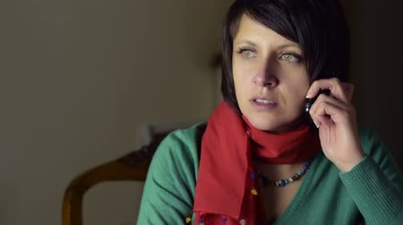 crows feet : Beautiful thoughtful woman talking on phone Stock Footage