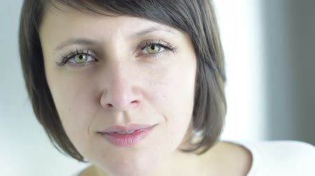 bámul : Emotional states: Close up portrait of beautiful green eyed brunette adult woman is in sad and pensive mood isolated Stock mozgókép