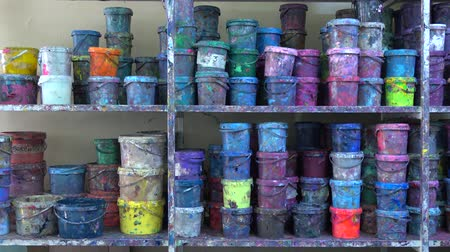 escolha : Industrial multicolor paint buckets storage 4K dolly shot