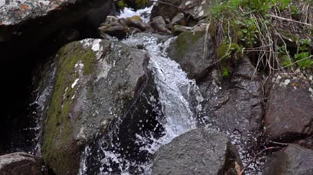 ridge line : Super slow motion video of small mountain river waterfall Stock Footage