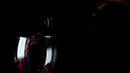 vinho : Pouring red wine into a wine glass super slow motion video, black background