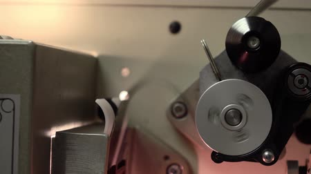 perforation : Dolly shot of film in professional film cinema projector, 4K video, part of set