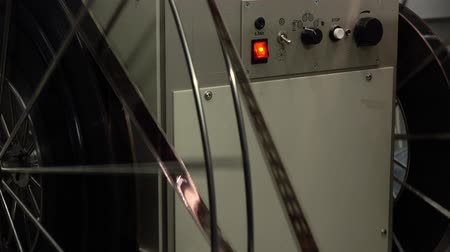 perforation : Dolly video of moving parts in pro cinema projector, 4K video, part of set