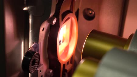 unreel : Dolly video of optical parts in film cinema projector in action. 4K, part of set
