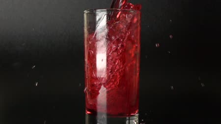 roma : 500 fps slow motion shot of cherry juice being poured in a glass