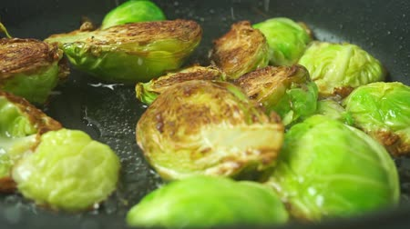 hiss : Turning over fried Brussels sprouts close up shot