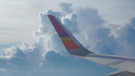 cümbüş : Colored aircraft wing edge against beautiful clouds