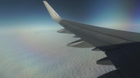 cümbüş : Passenger aircraft flying high above the clouds. Porthole view, aerial video