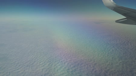 cümbüş : Airliner flying high above the clouds. Porthole view, aerial video