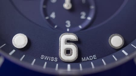 atrás : Blue clock dial of swiss made chronograph. Macro dolly shot