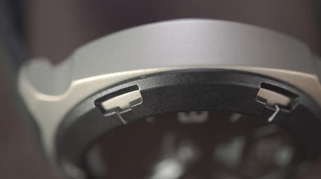 atrás : Aluminium sports watch macro dolly shot Stock Footage